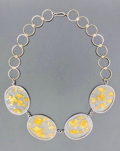 silver and resin necklace with 22 kt goldleaf
